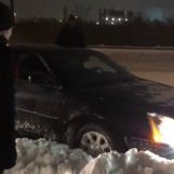 Stephen Amell Digging Out Car.mp4_000012181